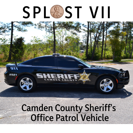 Black Camden County Sheriff's Office Charger with trees in the background